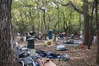 City workers on Monday cleared out a wooded area that served as an encampment for up to 30 homeless people near South Loop 288 and Duchess Drive.DRC