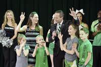 Grant McCasland and his family show eagle claws after McCasland was introduced as North Texas' new head coach in March. McCasland has made sure his family is involved with his team throughout rise through the coaching ranks.DRC