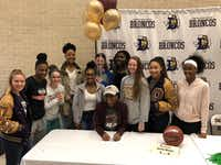 Jamie Means poses for a photo with her teammates during a signing ceremony at Denton High School on Wednesday, November 8. Means signed to play basketball at the University of Louisiana-Monroe.Courtesy photo
