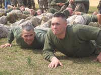 Wesley Rice, left, and Lyndon Villone, right, do push-ups next to each other in a training exercise.Courtesy photo