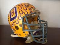 Matt Bateman's football helmet from Denton High School's 1987 season is displayed at his home.