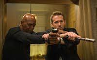 Samuel L. Jackson, left, and Ryan Reynolds in <i>The Hitman's Bodyguard</i>.AP