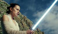 <i>Star Wars: The Last Jedi</i> begins where <i>The Force Awakens</i> left off, with Rey (Daisy Ridley) having tracked down Luke Skywalker. Walt Disney Pictures