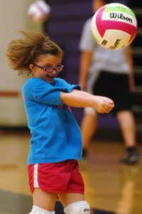 Hannah McCain, 11, practices volleyball at the Denton High School gym on June 22, 2011. Hannah and her family will be attending a conference sponsored by the Dwarfs Athletic Association. DRC