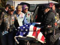 Members of the Patriot Guard Riders carry the flag-draped casket of John Walker during his funeral Wednesday at Dallas-Fort Worth National Cemetery in Dallas. Walker, a Vietnam War veteran, died in October in a Denton hospital. When no one came forward to claim Walker's body, DeBerry Funeral Directors in Denton stepped in and provided the service.NBC5