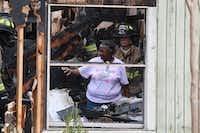 Longtime Sanger resident Cicily Price looks at the extent of the damage to her house after a fire Wednesday morning. Sanger's fire chief said she lost everything, including Christmas presents for her grandchildren.DRC