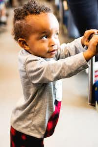 A boy waits for the Holiday Express train ride to depart on Saturday.DRC