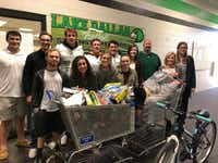 Members of both the Lake Dallas High School Student Council and football team donate toys and bike to the Lake Cities Spirit of Christmas organization. Pictured are, front row, from left, Blake Tatum, Gabby Thomas, Morgan Sams, Abbey Harrison and Spirit of Christmas Coordinator Sugene May; back row, from left, Cooper Erwin, Mason Turner, Hayden Brockenbush, David Blair, Ryan Hawley, Sydney Nunley, coach Mike Young and student council adviser Katie Burke.Lake Dallas ISD