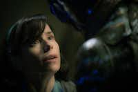 """This image released by Fox Searchlight Pictures shows Sally Hawkins, left, and Doug Jones in a scene from the film """"The Shape of Water.""""AP"""
