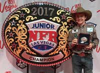 Denton roper Riley Webb displays his championship belt bucket after winning the 13 and under tie down roping championship Saturday at the Junior National Finals Rodeo in Las Vegas