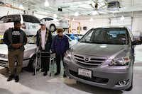 Dallas Cowboys running back Alfred Morris, left, and Denton residents John and Donna Marsh look over the couple's refurbished 2004 Mazda MPV on Tuesday at Classic Mazda of Denton. The vehicle was part of a pay-it-forward campaign by the Denton dealership.DRC