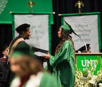 New UNT graduate Amber Lacy shakes hands with Dorothy Bland, dean of the Mayborn School of Journalism, after Lacy received her degree in broadcast journalism on Dec. 16.Courtesy photo