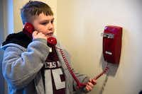 Ten-year-old Kai Goree calls the Little Elm Police Department to let them know their meals have arrived.DRC