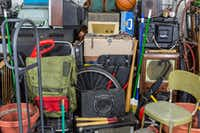 Want to bust clutter in 2018? Devoted Denton clutter-buster Shelly Tucker has a tip: Whatever you've got in your hands, don't put it down. Put it up. Messy pile of vintage objects.Getty Images/iStockphoto