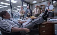 Washington Post editor Ben Bradlee (Tom Hanks), in foreground, confers with members of the newspaper's staff, played by, from left, David Cross, John Rue, Bob Odenkirk, Jessie Mueller and Philip Casnoff, in <i>The Post</i>.Twentieth Century Fox