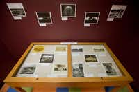 An exhibit in the Daughters of the Republic of Texas Library shows the Alamo through time.For The Texas Tribune