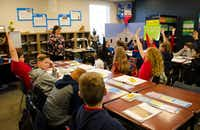 Margaret Carter teaches her fourth-graders about adjectives and character traits during class at Corinth Classical Academy on Tuesday. More students are enrolling in charter schools like Corinth Classical as networks expand throughout the state.DRC