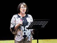 Patty Milam, who lost her son to heroin addiction, speaks to guests and welcomes guest speaker Tim Ryan on Thursday at Liberty Christian High School.DRC