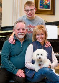 Ryan with his parents Doug and Jodi Bartek at their Frisco, Texas home on Jan. 19. Doug and Jodi support 29 Acres for people like Ryan who are on the autism spectrum. The 29 Acres program planned in Cross Roads will offer housing and employment opportunities for adults with autism.Special Contributor