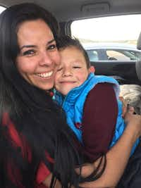 Rosalba Antonio embraces her nephew, Ricardo Alekzander Lara, in 2016 after authorities located him and his father, murder suspect Ricardo Alfonso Lara-Martinez, in Mexico. Lara-Martinez had taken the boy across the border in December 2014 after beating the boy's mother to death at a Denton office.