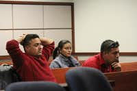 Brothers Angel Romero, left, and Gabriel Romero listen on Tuesday asJudge Bruce McFarling reads a 50-year prison sentence for the man who killed their sister. Ricardo Alfonso Lara-Martinez was convicted of beating Maria Isabel Romero Medina to death at an insurance office in Denton in December 2014.DRC