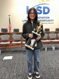 Lake Dallas Middle School seventh-grader Matthew Paro shows off his second place trophy after being named the runner up in the Denton County Spelling Bee. Paro represented the district at the contest in Lewisville earlier this month and competed against other students from public, charter and private schools throughout the county.Courtesy photo
