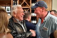 Denton County Commissioner Pct. 4 candidate Jim Carter, left, shakes hands with Denton County Commissioner Andy Eads, during a watch party at Hannah's Off the Square, Tuesday, March 6, 2018, in Denton, Texas, Jeff Woo/DRCDRC