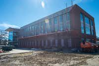 Crew members work on the new Denton ISD Administration Building located in the 1300 block of North Elm Street in Denton.DRC