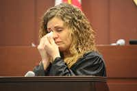 Amber Climer, 33, wipes away tears on Thursday as she becomes the first graduate of the year-old Denton County Family Drug Court in Judge Tiffany Haertling's 442nd Judicial District Court.DRC