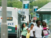 DCTA passengers leave buses parked at the Downtown Denton Transit Center, where they can connect to the northernmost stop on the A-train.DRC file photo