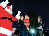 Meeting Santa Claus on stage before  throwing the switch, Avery Withers was the official tree lighter at the 2012 Denton Holiday Lighting Festival on Friday.David Minton - DRC