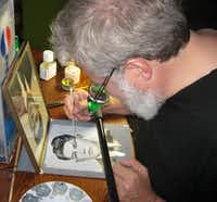 "Tim Jenison makes a painting of a photograph of his father-in-law using his invention, the ""comparator mirror,"" in the documentary ""Tim's Vermeer.""Sony Pictures Classics"
