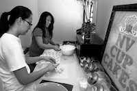 Ngoc Nguyen (left) and sister, Van Nguyen, make cake balls Thursday in the kitchen of their cupcake shop in Denton.Al Key/DRC