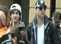This photo released by the FBI early Friday April 19, 2013, shows what the FBI is calling the suspects together,  walking through the crowd in Boston on Monday, April 15, 2013, before the explosions at the Boston Marathon.Uncredited - AP