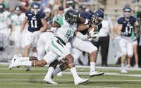North Texas cornerback Nate Brooks chases Rice receiver Parker Smith at Rice Stadium  in Houston. Brooks joined safety Kishawn McClain on the Preseason All-Conference USA team.File photo