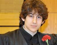In this undated photo provided by Robin Young, Dzhokhar A. Tsarnaev, poses for a photo after graduating from Cambridge Rindge and Latin High School. Tsarnaev has been identified as the surviving suspect in the marathon bombings. Two suspects in the Boston Marathon bombing killed an MIT police officer, injured a transit officer in a firefight and threw explosive devices at police during a getaway attempt in a long night of violence that left one of them dead and another still at large Friday, April 19, 2013.Robin Young - AP