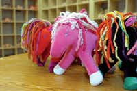 Dragonfly's Hollow also makes stuffed critters, like these brightly colored ponies.Al Key/DRC