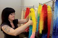 Lindsay Lee, an assistant at Dragonfly's Hollow, dyes yarn into bright colors from a neutral base color on Monday at the shop in DentonAl Key/DRC