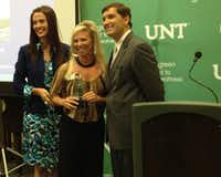 Jaycee Jones, middle, represents Bill Utter Ford as one of four area companies given the Pinnacle Award by United Way campaign chairman Dr. Sheri Dragoo and chairman-elect Greg Sawko during Thursday's 2012 United Way of Denton County Pacesetter Campaign reception at the University of North Texas.Courtesy photo