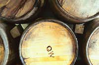 New charred white oak barrels bear the initials QW for Quentin Witherspoon, who runs Witherspoon's Distillery in Lewisville.David Minton - DRC