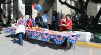 Behind DATCU's main headquarters in downtown Denton, members enjoy an Election Day-themed appreciation lunch with hot dogs, chips and cupcakes adorned with red and blue sprinkles.DRC photo