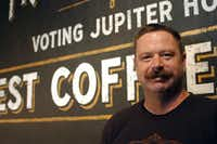 Sean Starr stands in front of a mural he painted for Jupiter House Coffee. Starr runs Starr Studios, a branding, design and sign painting studio in Denton.DRC/David Minton