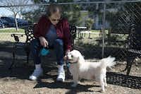 Dogwood Estates resident Deloris Cook pets her dog, Sam, on Thursday at the new dog park the Denton senior living center.Tomas Gonzalez