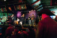 "By the time A Taste of Herb picks up its second set Tuesday at Dan's Silverleaf, the sun has set and the bar is bustling. The band includes, from left, Paul Slavens on keyboard, Joe Cripps on percussion, Tex Bosley on drums and trumpet player John Weir. Bassist Ross Schodek, far right, keeps the rhythm. The tribute band's name riffs on the song ""A Taste of Honey,"" a popular cover by Herb Alpert's Tijuana Brass.David Minton - DRC"