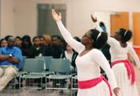 "Denesha Factory, a recreation specialist at Martin Luther King Jr. Recreation Center, performs a praise dance during the ""Sowing the Seeds of Service"" program, part of Denton's Martin Luther King Jr. Celebration, on Saturday.DRC - David Minton"