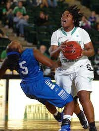 North Texas sophomore guard BreAnna Dawkins, right, drives into Middle Tennessee guard Shanice Cason on Jan. 24 at the Super Pit. Dawkins scored 10.1 points per game after transferring from Wichita State.David Minton - DRC