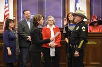 16th District Court Judge Sherry Shipman swears in Jerry Raburn as constable for Denton County's Precinct 3 on Sunday at the Courthouse on the Square. Raburn, who has served as constable since 1993, said he plans for this term to be his last.Tomas Gonzalez - DRC