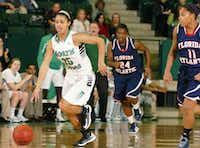 North Texas freshman guard Loryn Goodwin, left, goes after a loose ball against Florida Atlantic on Feb. 20 at the Super Pit. Goodwin was named Sun Belt Conference freshman of the year.David Minton - DRC