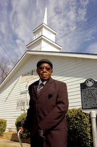 The Rev. Lloyd Pullam stands in front of the St. Emmanuel Missionary Baptist Church on Friday in Denton.Al Key - DRC