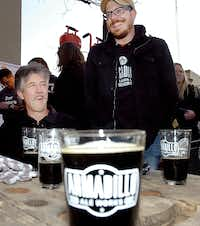 Armadillo Aleworks founder Bobby Mullins (right) and his father Robert Mullins at the Oak Street Drafthouse celebrating the unveiling of the local brewery's new beverage, Quakertown Stout, Friday March 1, 2013, in Denton.Al Key - DRC